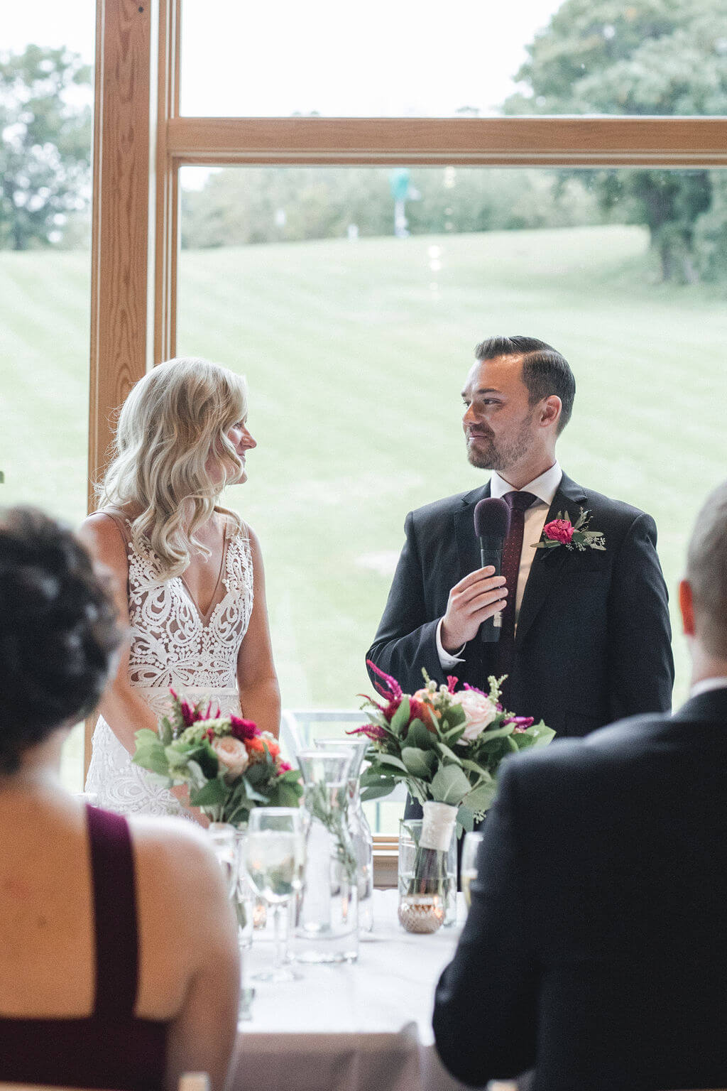 Ashley and Tom | Mariah Brink Photo | Hyland Hills Wedding | Sixpence MN wedding planner | head table in front of the main windows