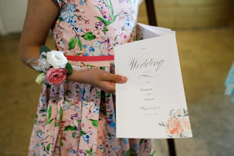program, usherette with wrist corsage | Salty Raven Photography | PAIKKA | Sixpence Events | Eleanor and Aaron's wedding.jpg