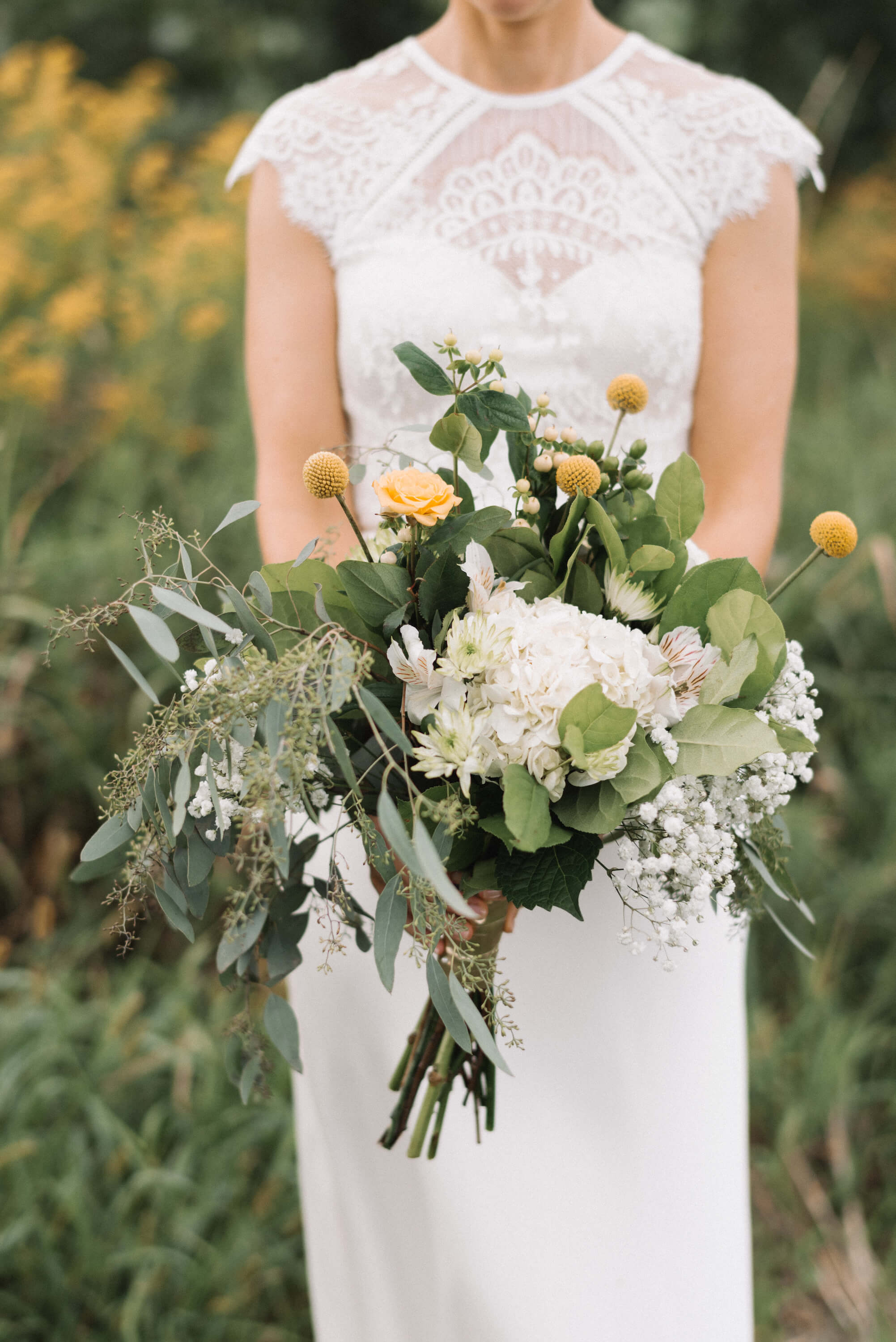 bridal bouquet with billy balls | Jonny and Liz Minnesota Wedding Photographers | Sixpence day of coordinating at Gale Woods farm venue near the lake.JPG