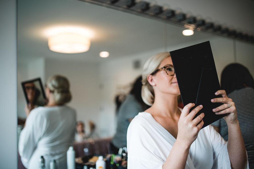 bride looking at her bun | Cristina Ziemer beauty | Kelly and Matt | Hutton House | Aqua Fox Photography | Sixpence Events and Planning Minnesota Wedding Planner30.jpg