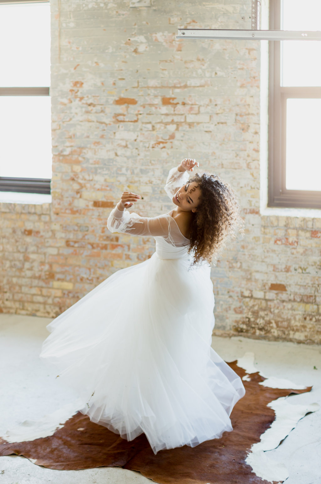 tulle skirt bride with naturally curly hair | Abigail Berge Photography :: White House Co :: Olive Branch Botany :: Modehaus :: Sixpence Events and Planning blog.jpg
