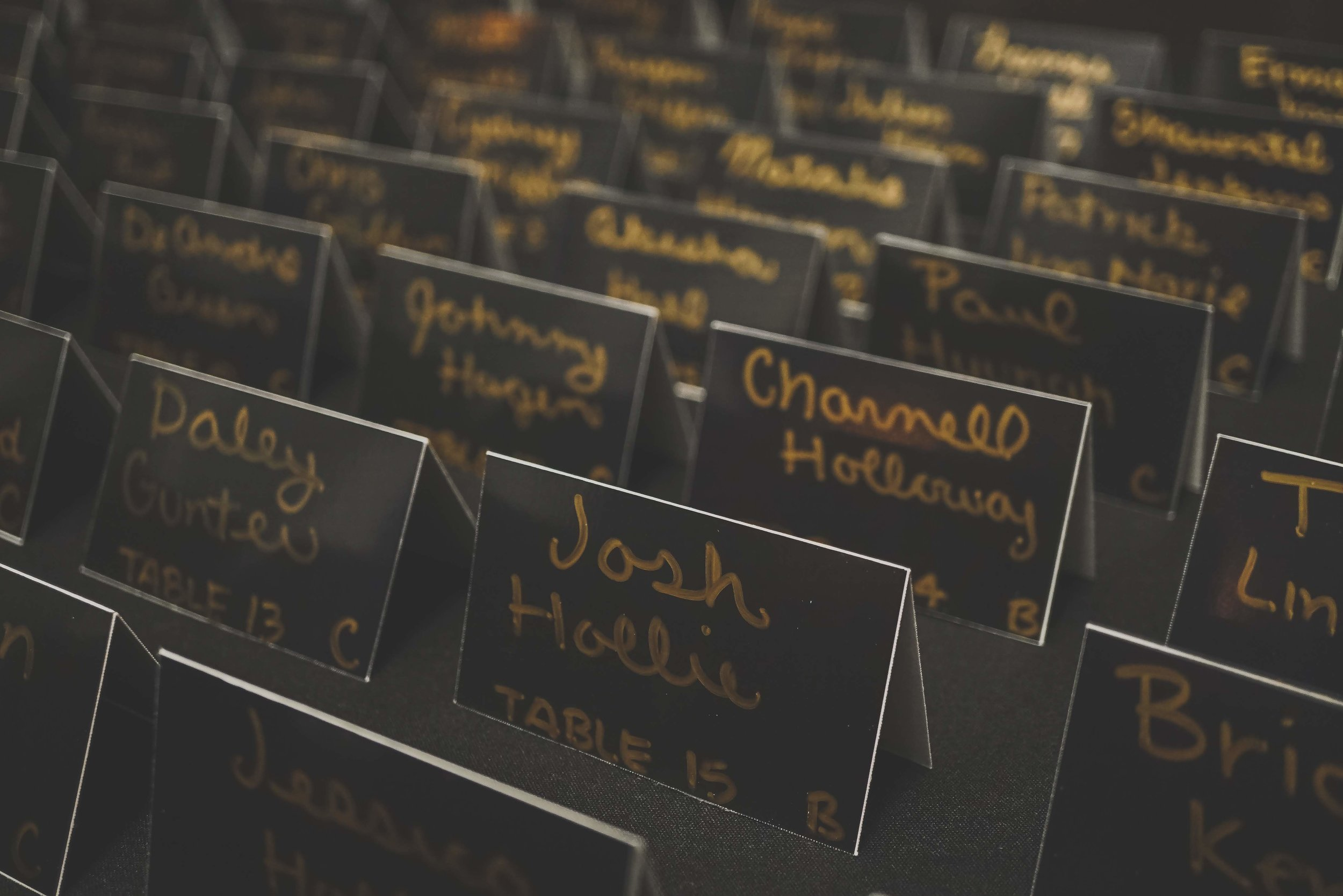 black place cards with gold writing  | Danny Photography | Minnesota wedding planner Sixpence Events | The Blaisdell