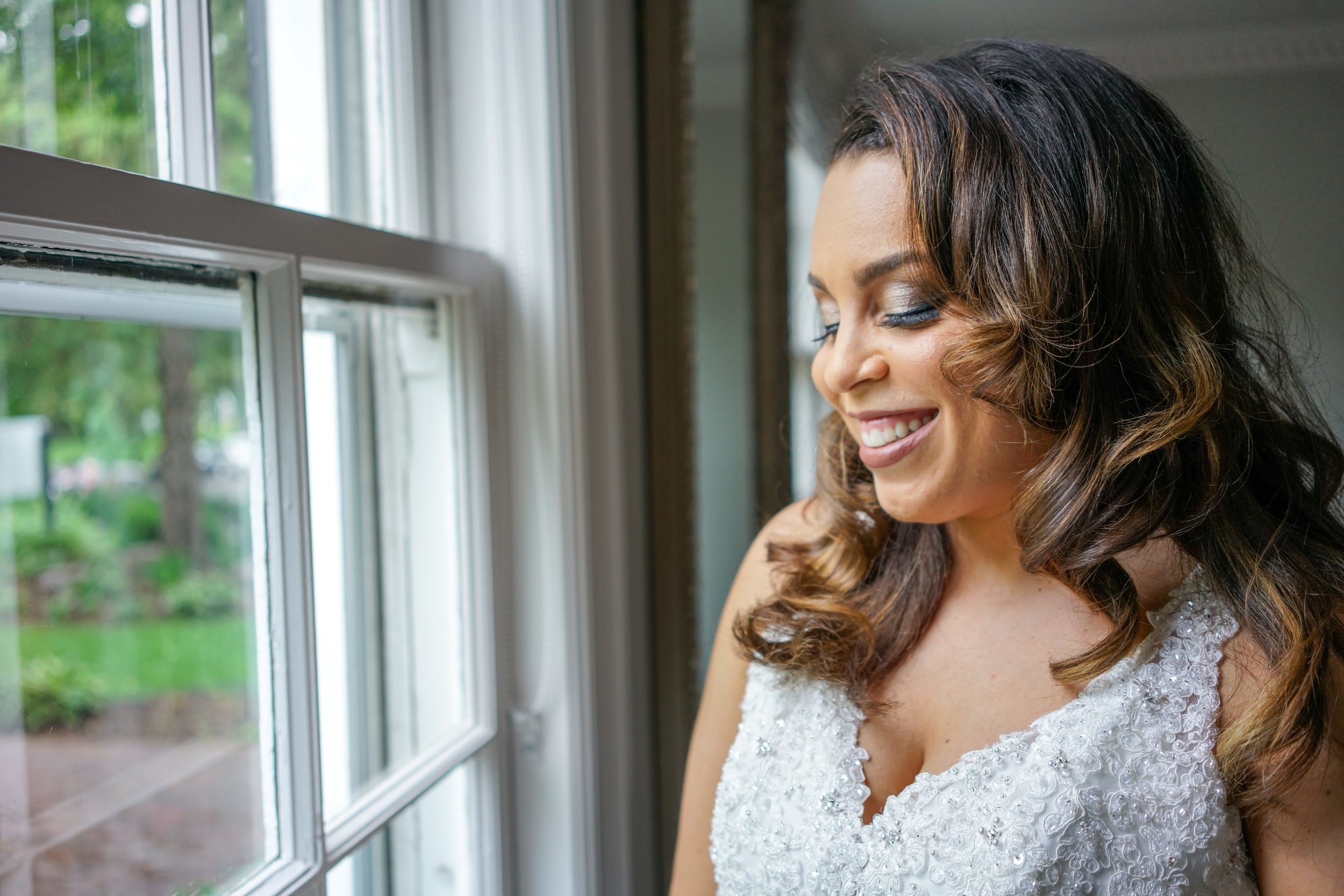 soft waves bride in the window  | Danny Photography | Minnesota wedding planner Sixpence Events | The Blaisdell