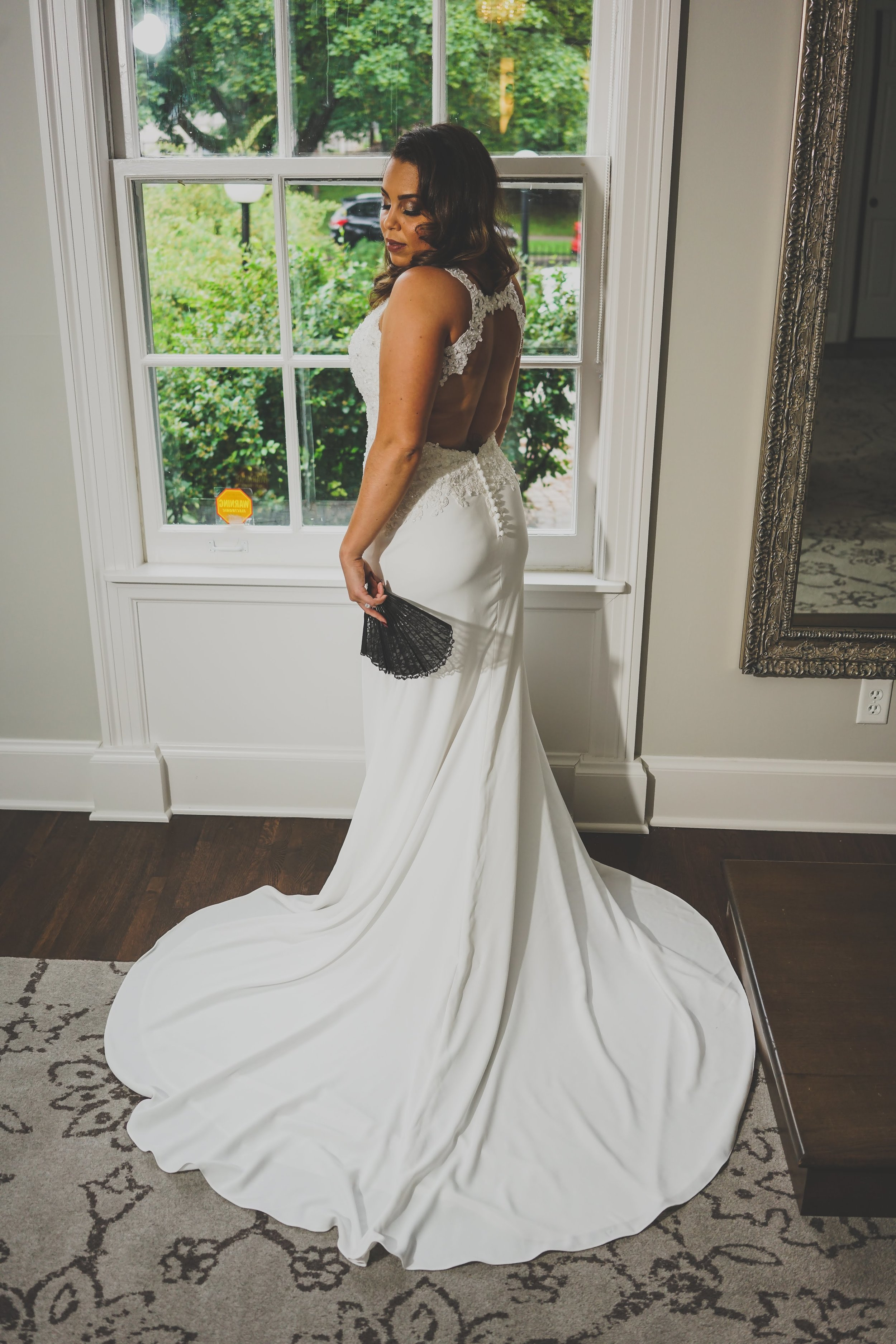 bride with black fan | keyhole wedding dress back | soft curls |  | Danny Photography | Minnesota wedding planner Sixpence Events | The Blaisdell