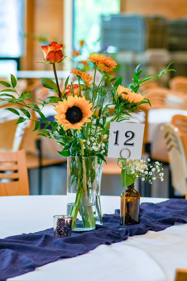 Amy Wurdock Photography Ned Loves Ryan | SIxpence Events Day of Coordinating at Silverwood park | DIY flowers with orange and purple runner