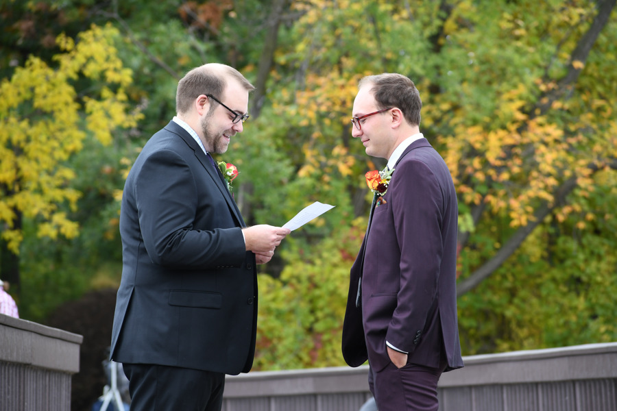 Amy Wurdock Photography Ned Loves Ryan | SIxpence Events Day of Coordinating at Silverwood park | grooms reading vows on the bridge