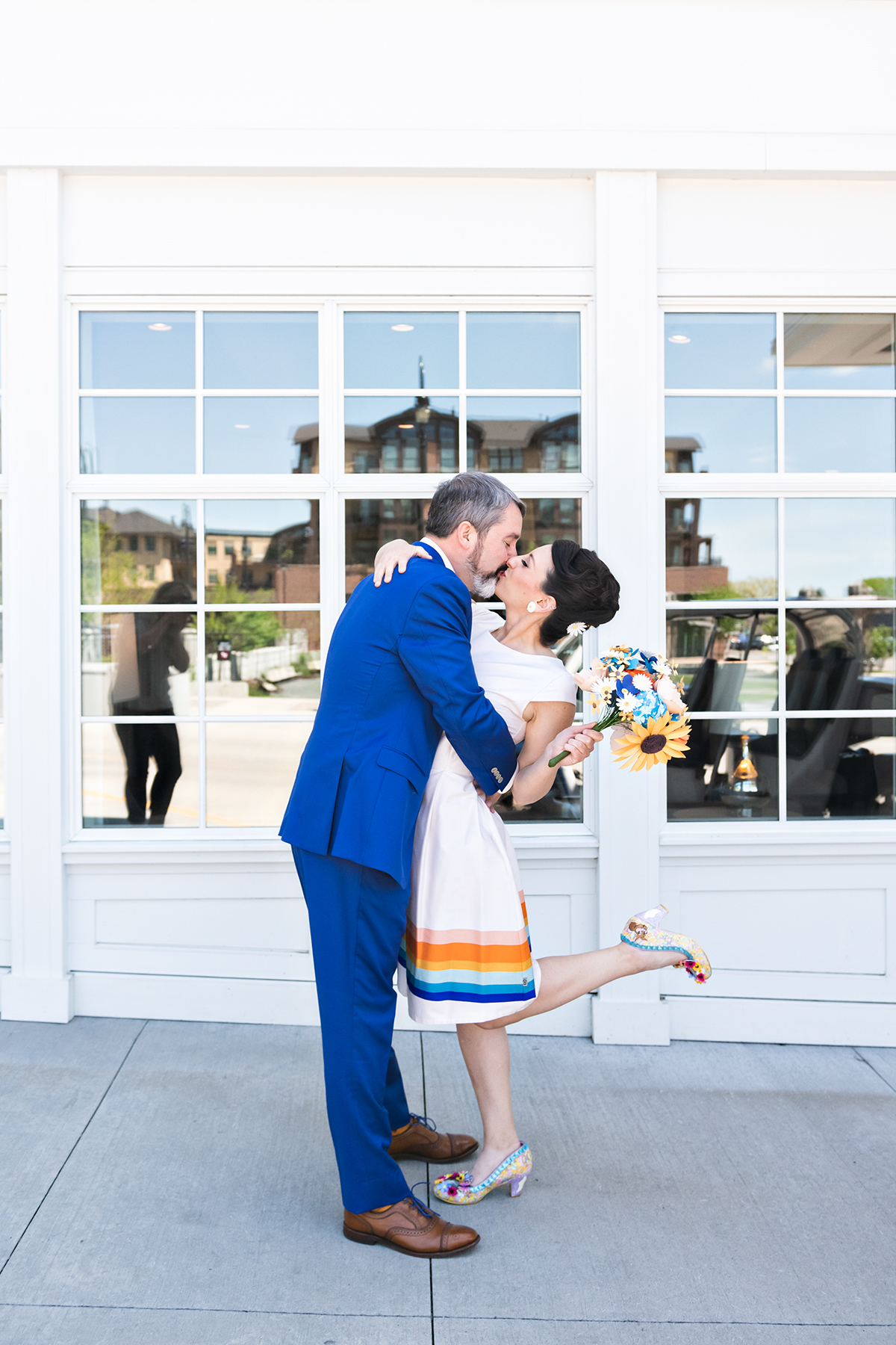 first look at Hotel Landing   bride in rainbow dress   Robin + Tom   Holey Moley contestants   Shuttersmack Minnesota photographer   Sixpence Events and Planning   Gale Woods Reception   Big Stone Mini Golf   .jpg