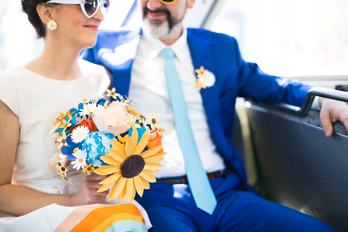 groom in bright blue suit with Robin's egg blue tie   paper flowers   bride wearing daisy earrings   Robin + Tom   Holey Moley contestants   Shuttersmack Minnesota photographer   Sixpence Events and Planning   Gale Woods Reception   Big Stone Mini Golf   .jpg