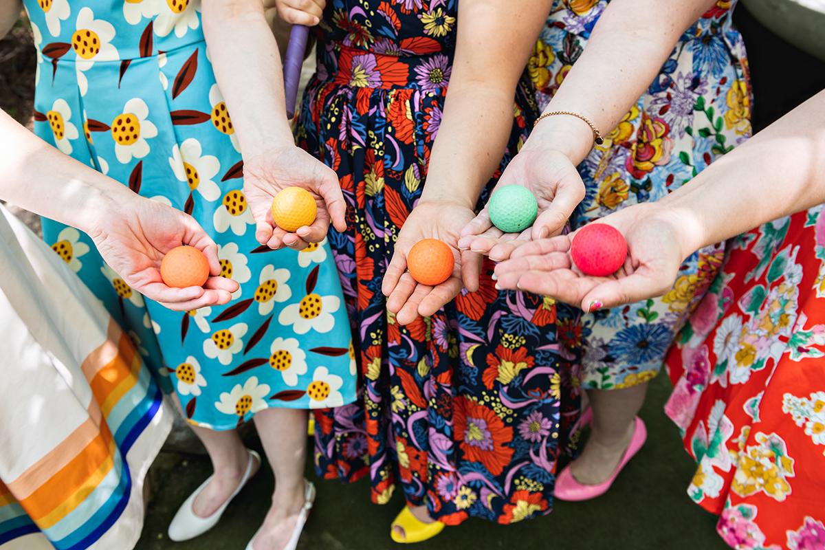 colored balls flower print bridesmaid dresses   Robin + Tom   Holey Moley contestants   Shuttersmack Minnesota photographer   Sixpence Events and Planning   Gale Woods Reception   Big Stone Mini Golf   .jpg