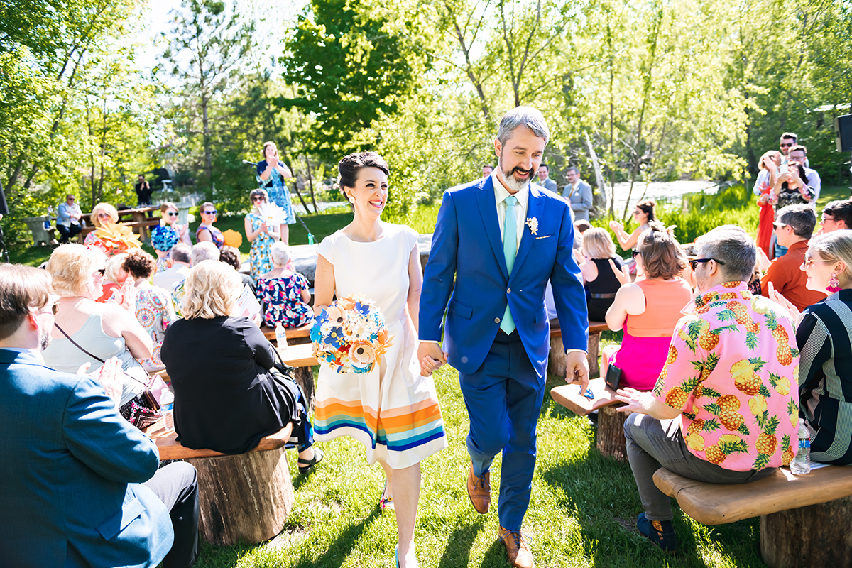couples recessional at Big Stone   Robin + Tom   Holey Moley contestants   Shuttersmack Minnesota photographer   Sixpence Events and Planning   Gale Woods Reception   Big Stone Mini Golf   .jpg