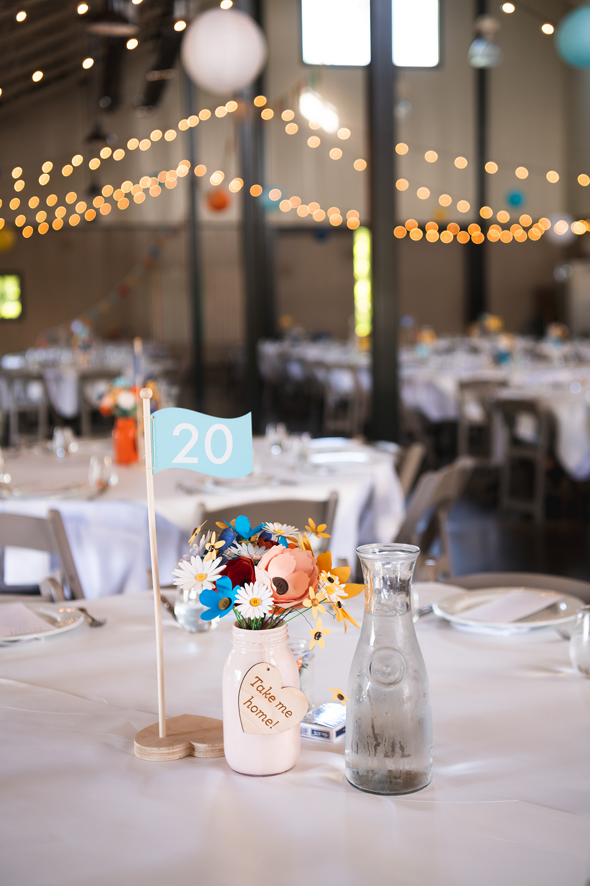 colored mason jars, paper flowers and mini golf hole flag table numbers   Robin + Tom   Holey Moley contestants   Shuttersmack Minnesota photographer   Sixpence Events and Planning   Gale Woods Reception   Big Stone Mini Golf   .jpg