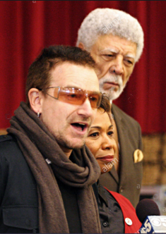 Bono speaks about HIV/AIDS epidemic alongside Rep. Barbara Lee and Ron.