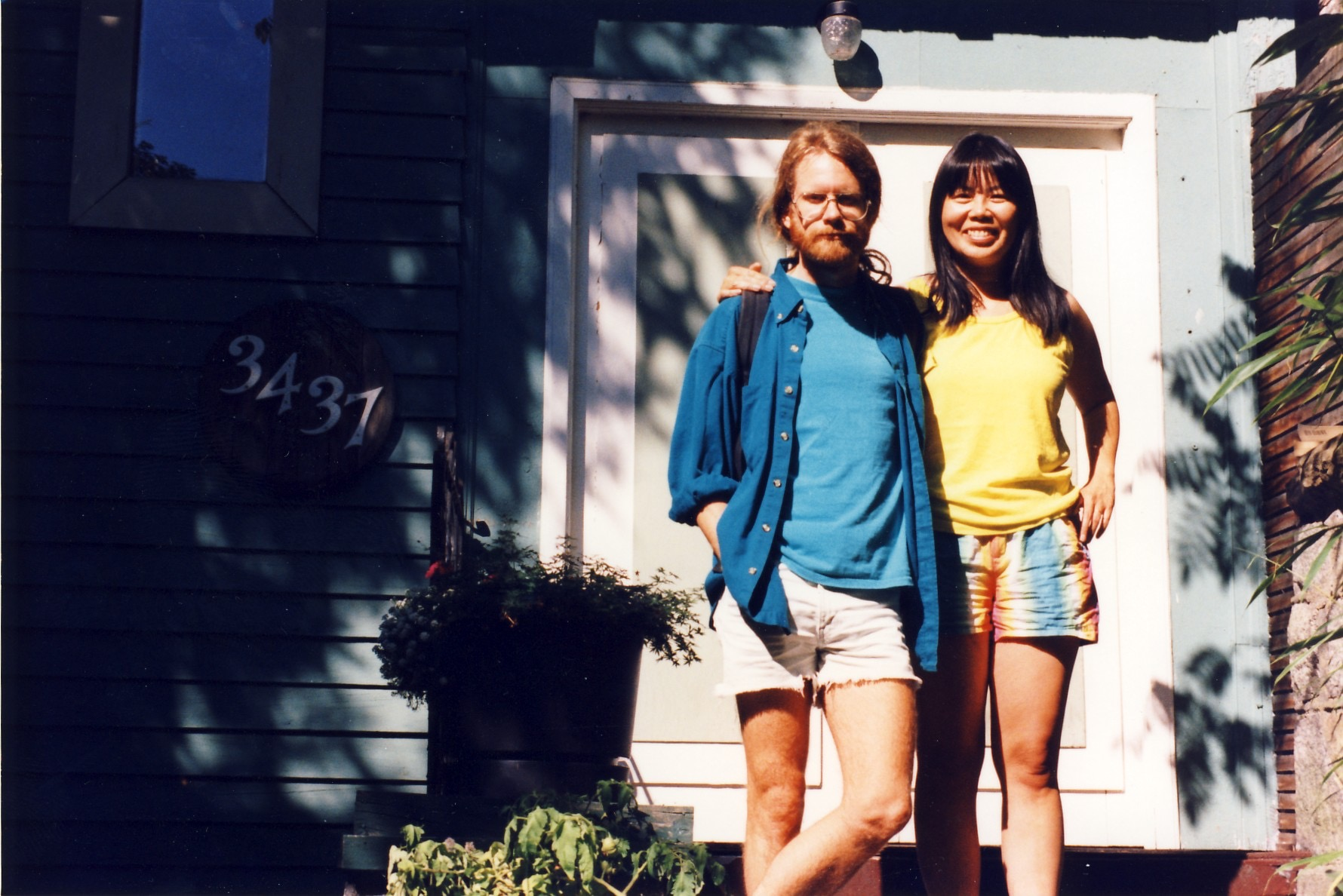In the 90s we lived in Kitsilano while I did a Ph.D. at UBC. We had alot of parties. Eight years later I got my degree — and turned my thesis into a book,  Stranger Gods: Salman Rushdie's Other Worlds  (McGill-Queen's, 2001). Here we are in front of the house we shared with Rob and Jackie.