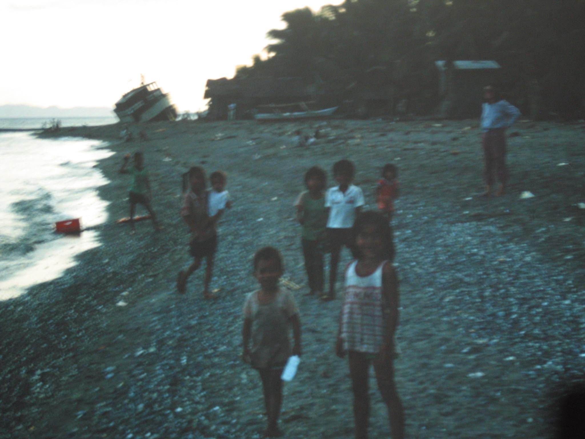 Filipino kids on a beach, perhaps in Puerto Galera, I'm not sure (we went to alot of islands — some of them economically grim, all of them beautiful).