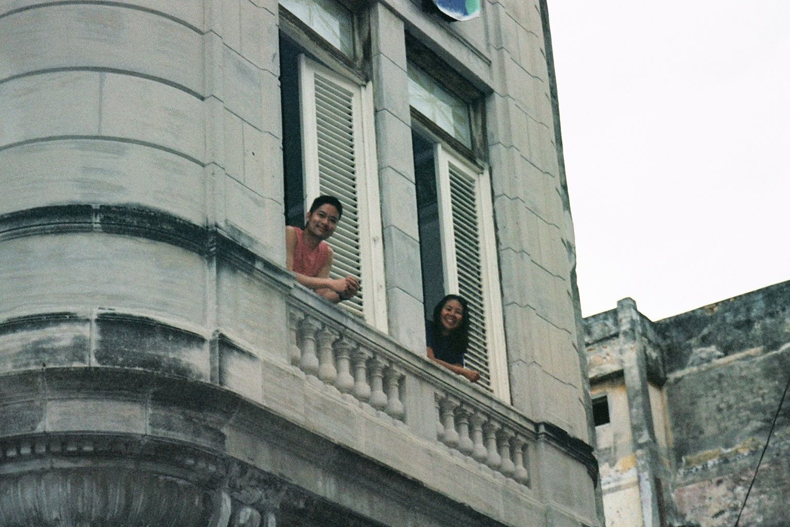 Greg and Ruby leaning out of our Havana casa, 2004.