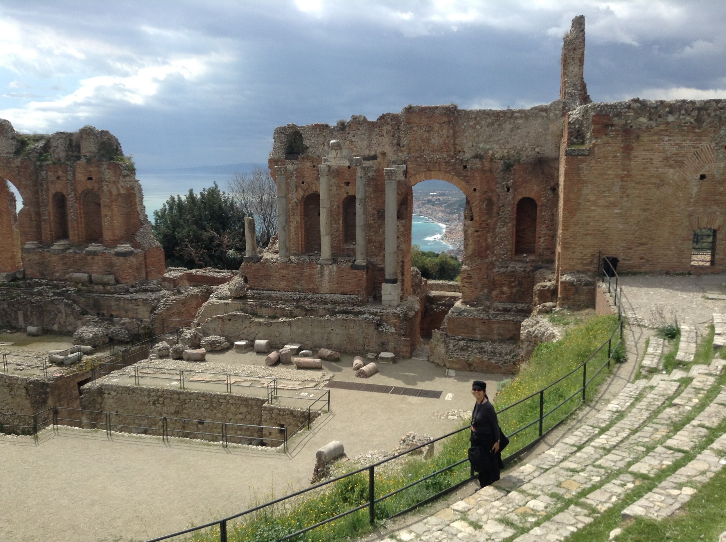 In northeast Sicily, the town of Taormina is famous for its Greco-Roman theatre perched on the hillside overlooking the Ionian sea.