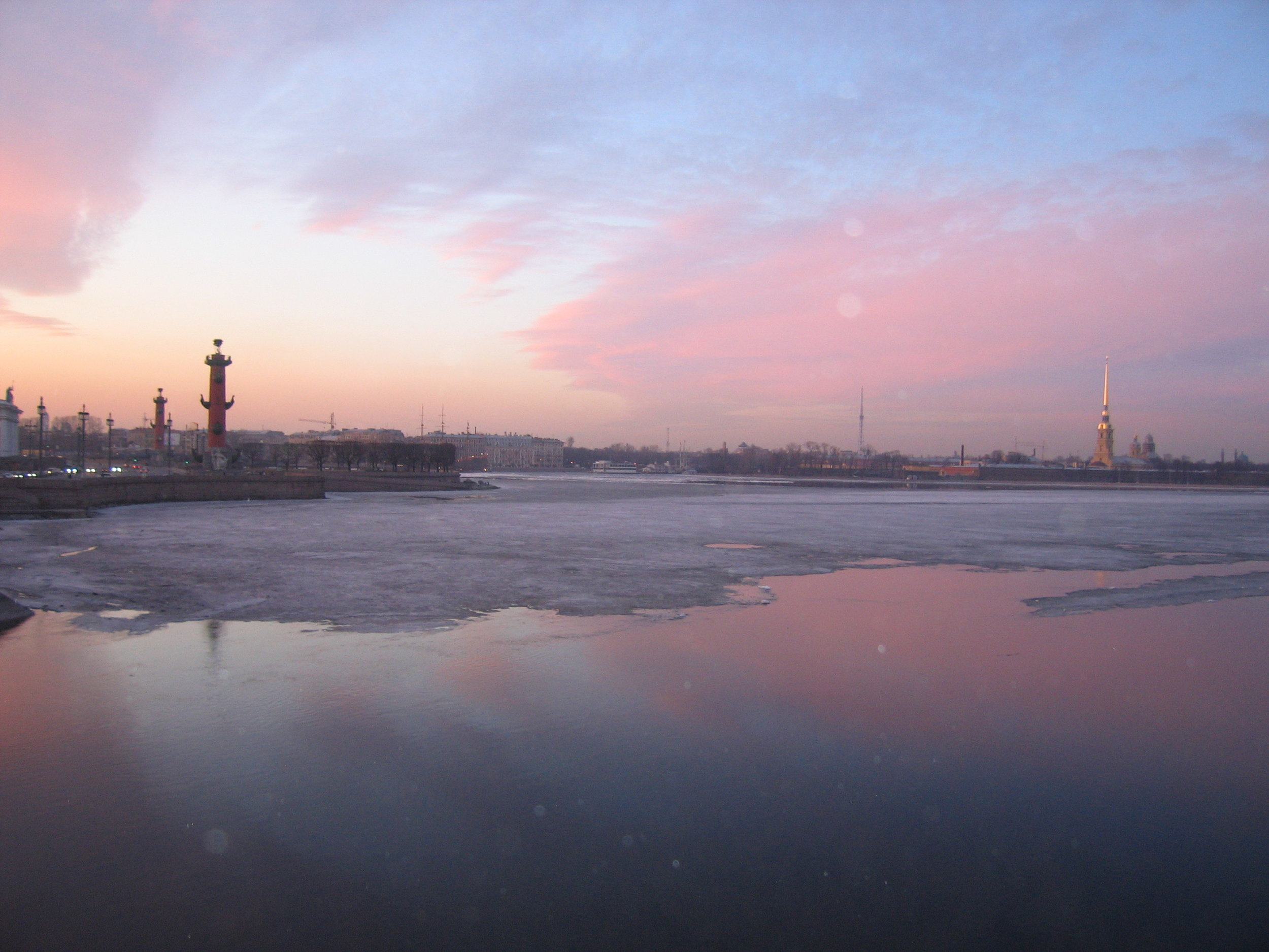 The Neva River runs through St.Petersburg. The April weather is turning the surface ice into water.