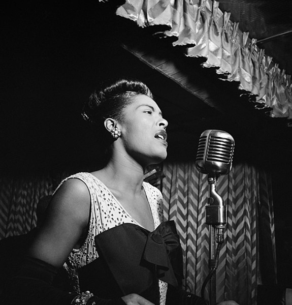Billy Holiday at the  Downbeat  club, New York, c. February 1947; Beyoncé. Both from Wikimedia Commons.