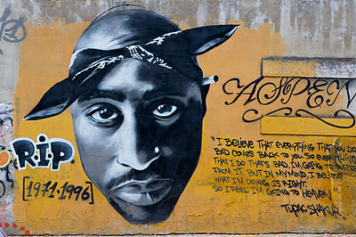 """This graffiti art is a tribute to West Coast rapper  Tupac Shakur , who was killed in a drive-by shooting (photo  r2hox  from Madrid, Spain) (Wikimedia Commons)"