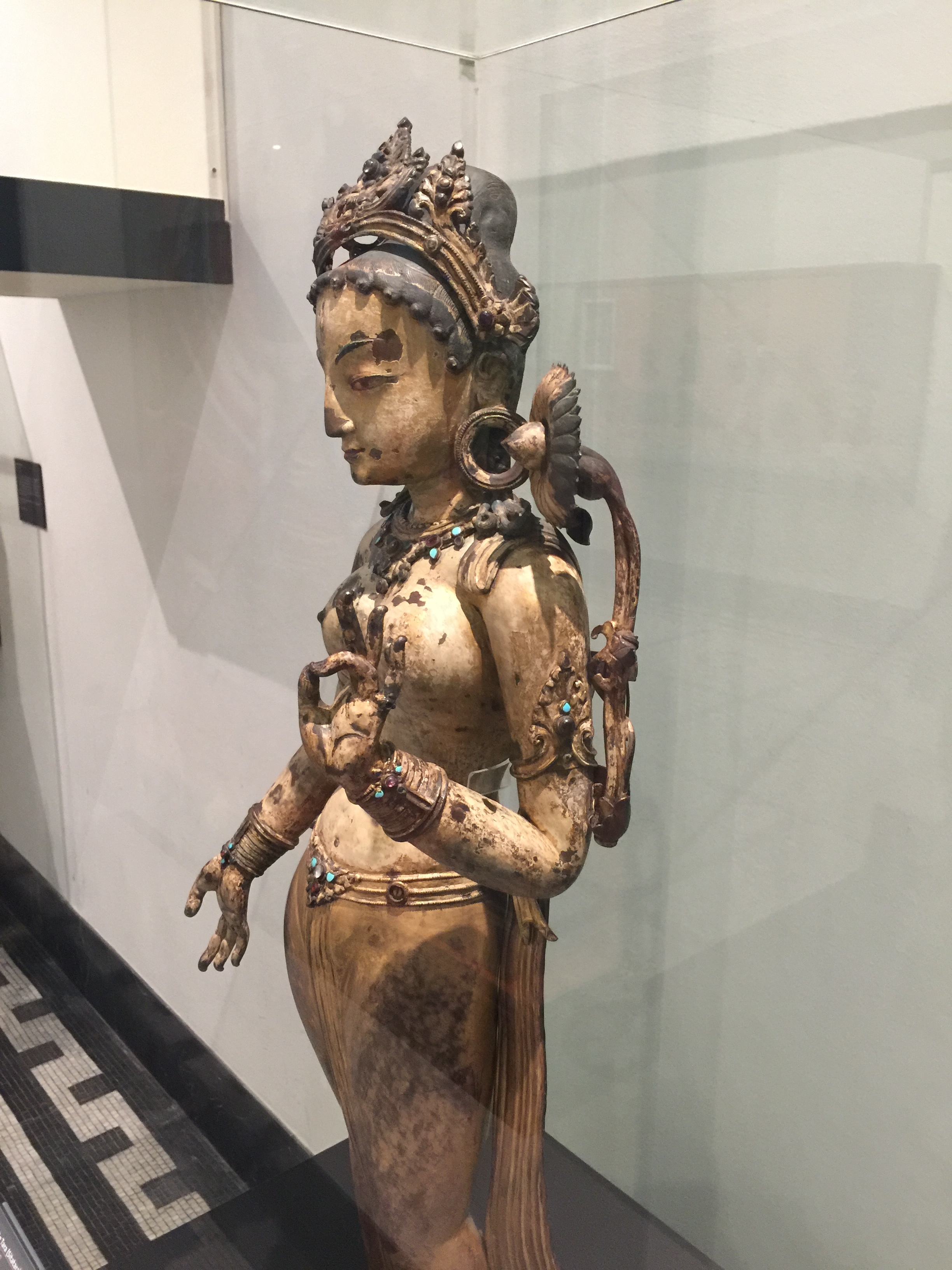 White Tara with lotus over shoulder and giving a blessing, Nepal, 1300-1400. In Buddhism, Tara is associated with liberation, compassion, and success. From the Victoria & Albert Museum.
