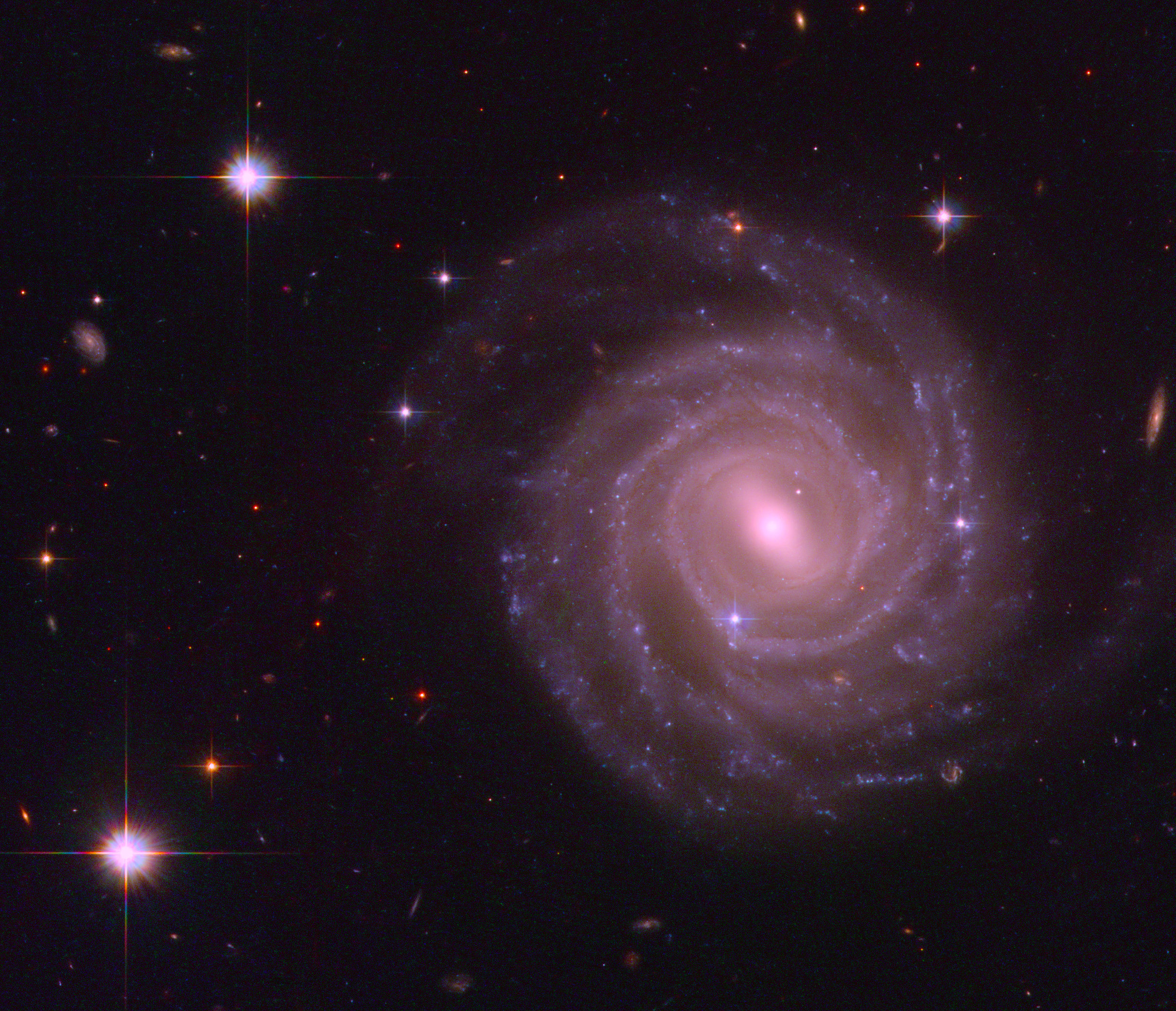 """""""An HST image of galaxy UGC 12158, which is thought to resemble the Milky Way in appearance"""" (cropped and coloured by RYC), from ESA/Hubble & NASA, http://www.spacetelescope.org/images/potw1035a/ (Wikimedia Commons)"""