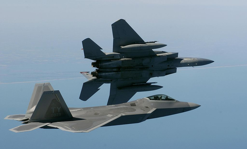 Birds of a feather ...  OVER THE ATLANTIC OCEAN -- An F-15 Eagle banks left while an F/A-22 Raptor flies in formation en route to a training area off the coastline of Virginia on April 5.  http://www.af.mil/shared/media/photodb/photos/050405-F-2295B-047.jpg  From Wikimedia Commons
