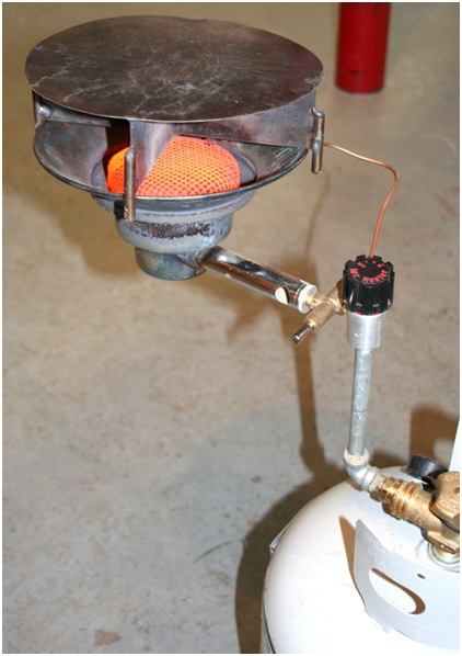 "Figure 1. Hot plate mounted on a propane heater used for conducting ""pop"" tests at the Aberdeen Plant Materials Center."
