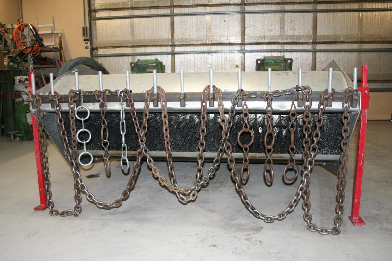 Figure 4. Loops of heavy log chain replaced the rigid pipe rake allowing for multiple, non-destructive harvests. Photo by Derek Tilley.