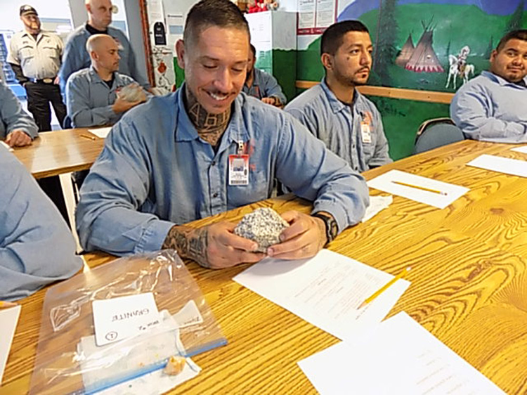 Snake River Correctional Institute Inmates examine fossils as part of an educational lecture (photo: Nancy DeWitt)