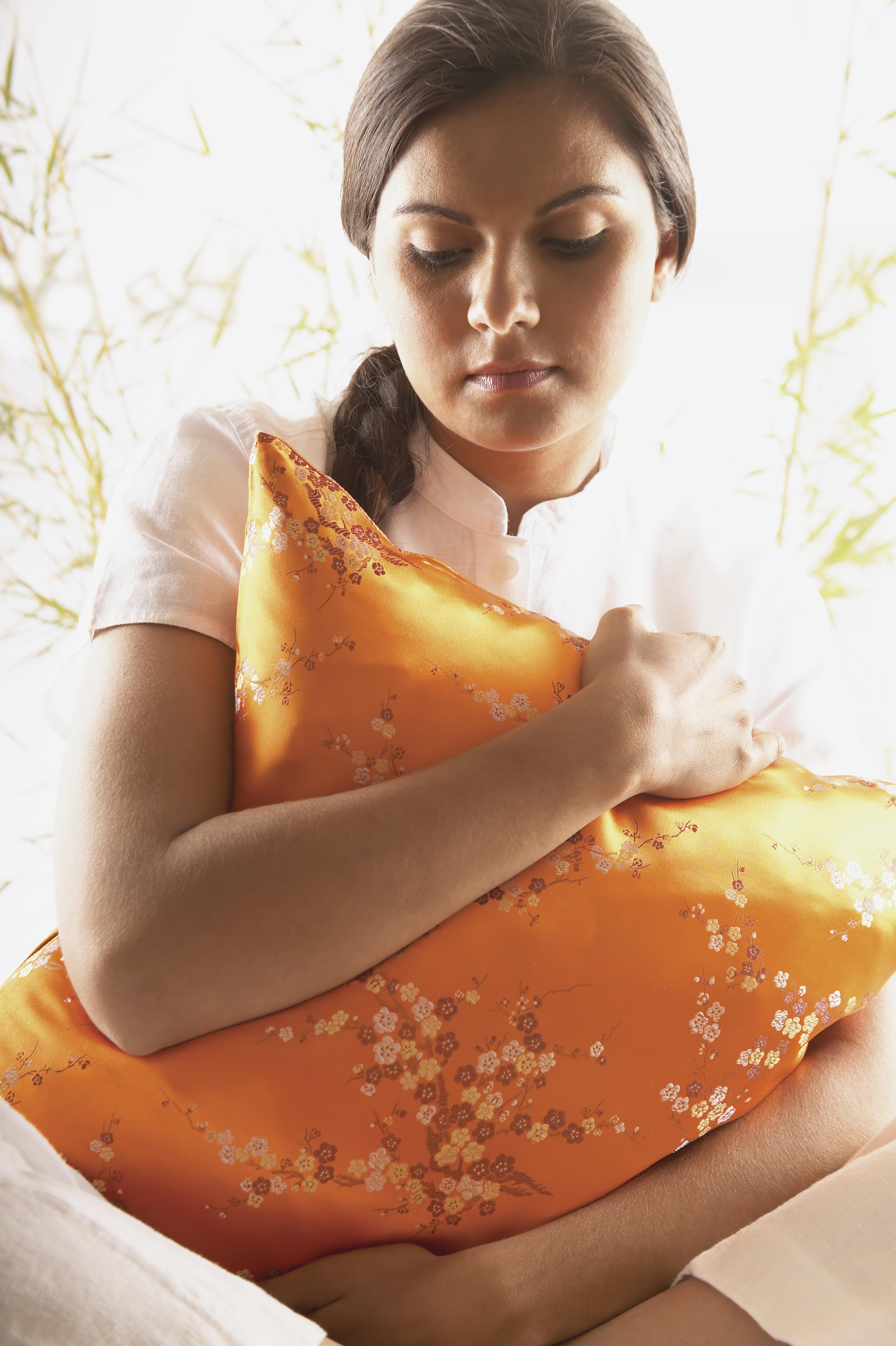Woman hugging cushion