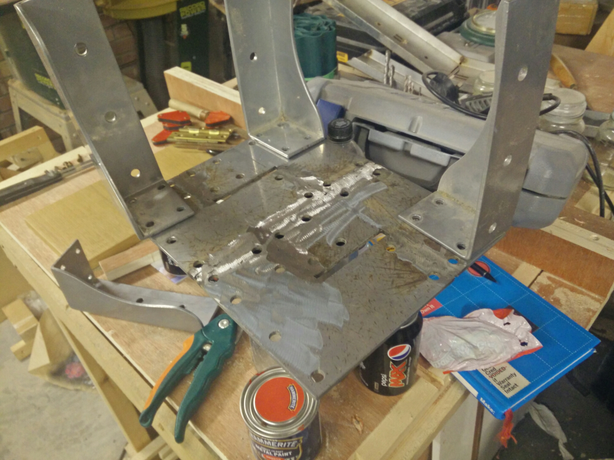 Laying out pieces of metal stool