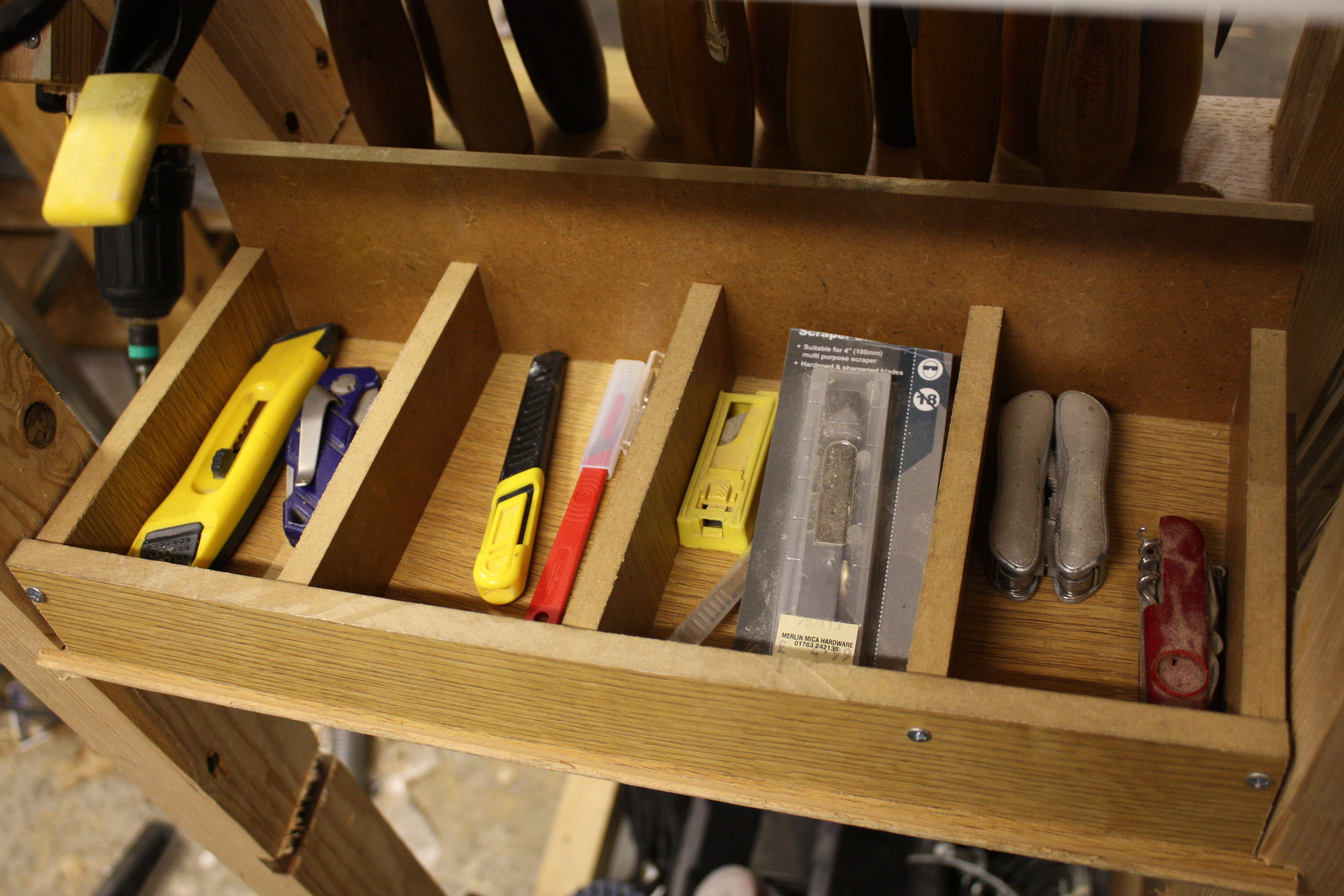 Rear storage for box cutters/craft knives, multi tools etc