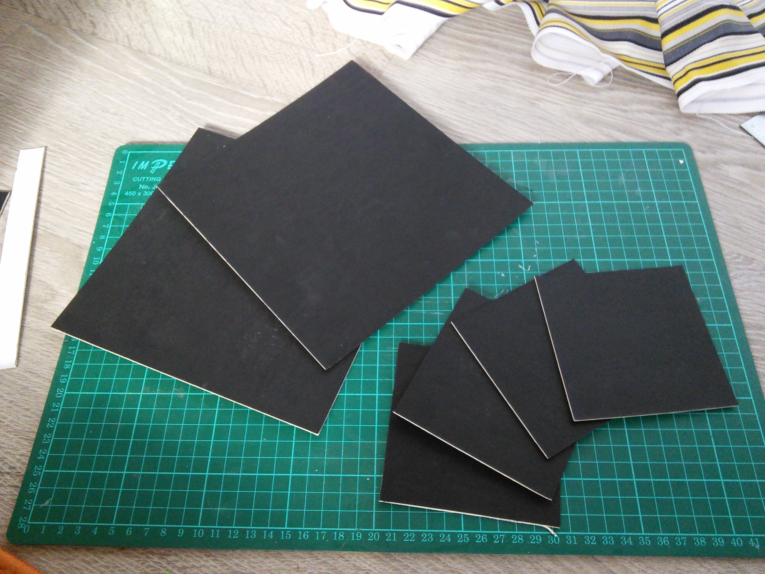 The colour of the mountboard is unimportant as it will be completely covered by fabric. However, I discovered that the dye in this dark card had a tendency to come off when the glue was applied. Not enough to be a problem, but enough for me to recommend using a light coloured card as your core.