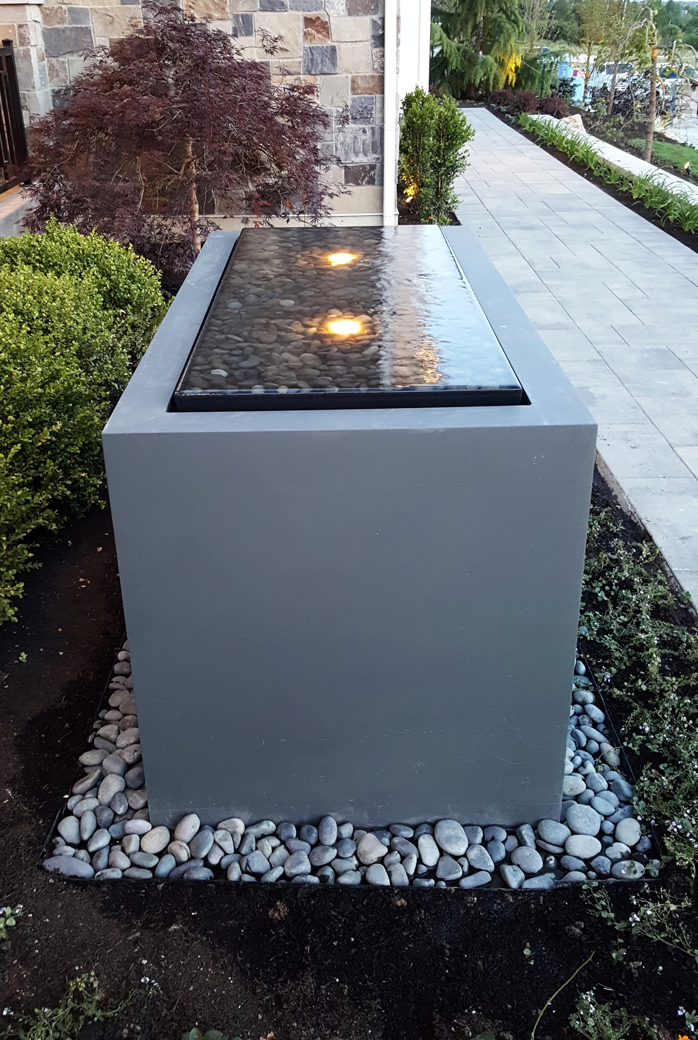 "The ""Pensive"" water feature shown with optional LED lights."