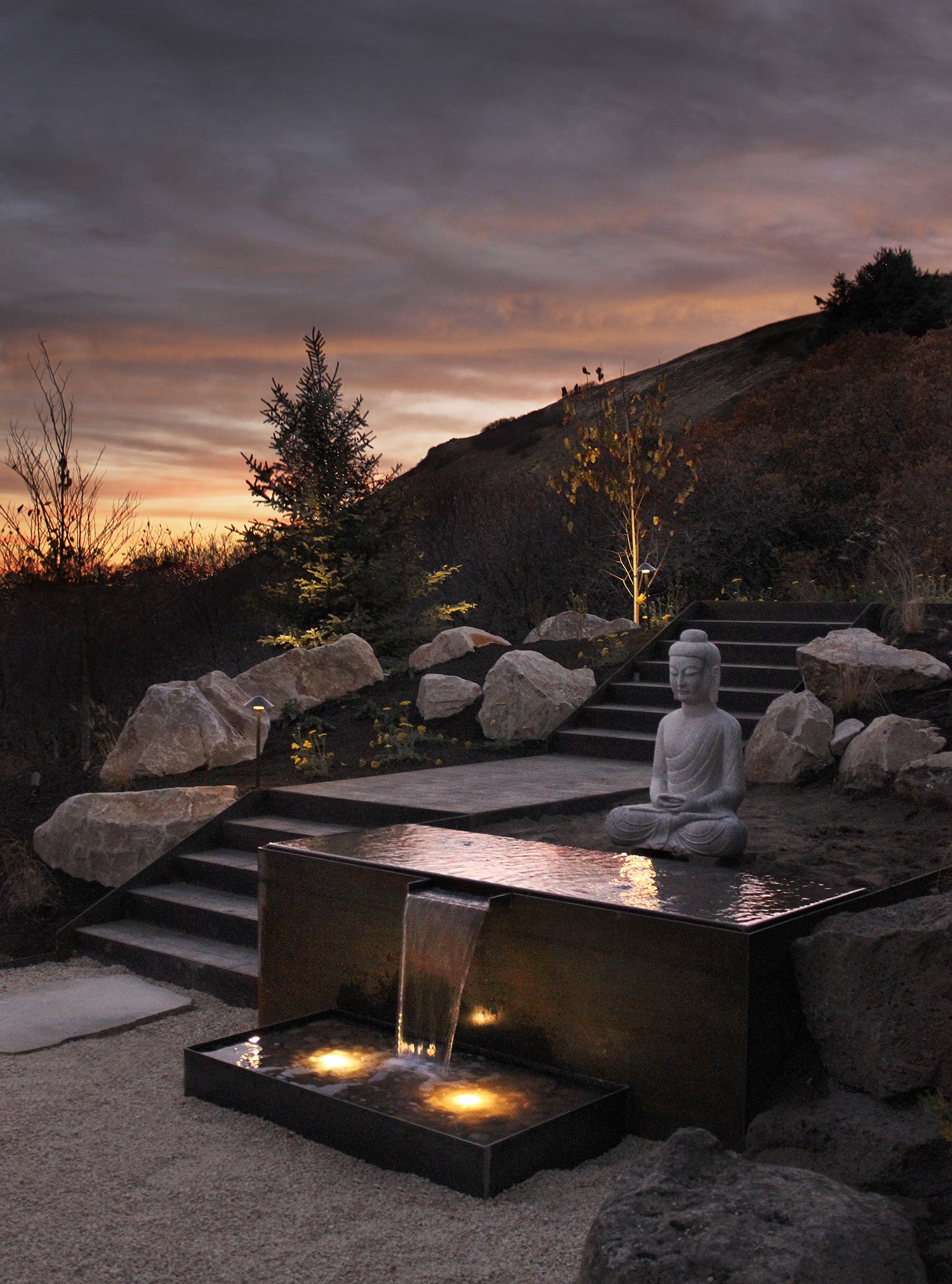 Custom steel water feature with infinity edge reflecting pool and optional LED lights.