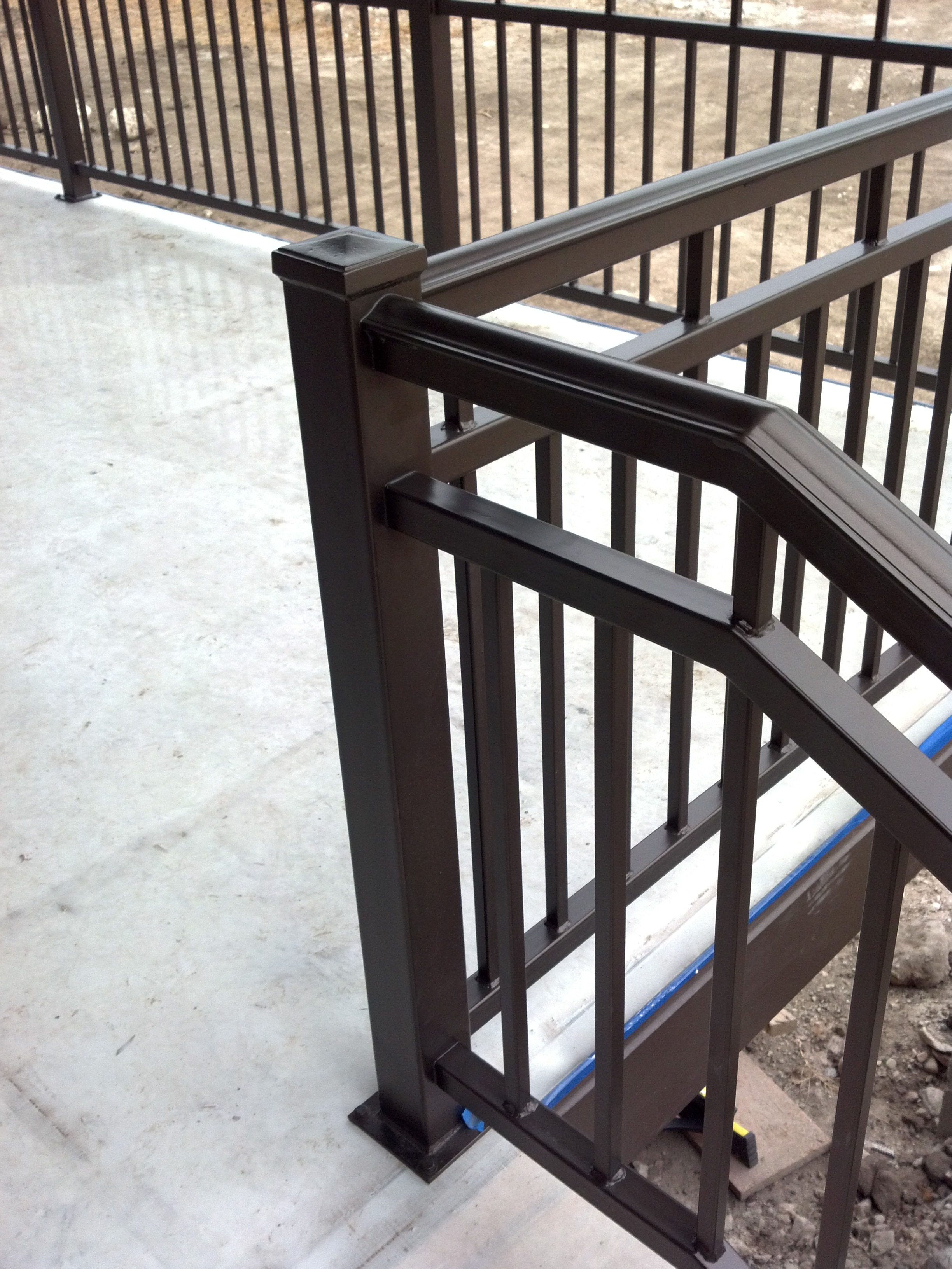 Decorative powder coated rail on a patio.