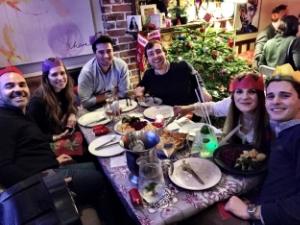 Enjoying a communal dinner in London.