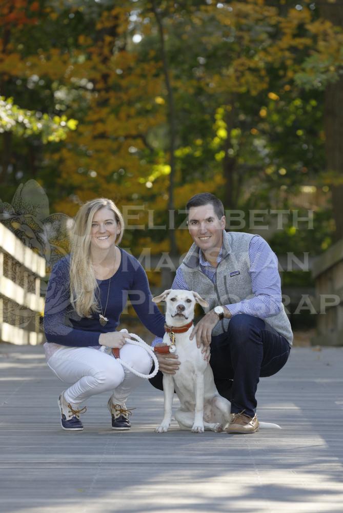 _X6A1792 kneeling on bridge with dog.jpg