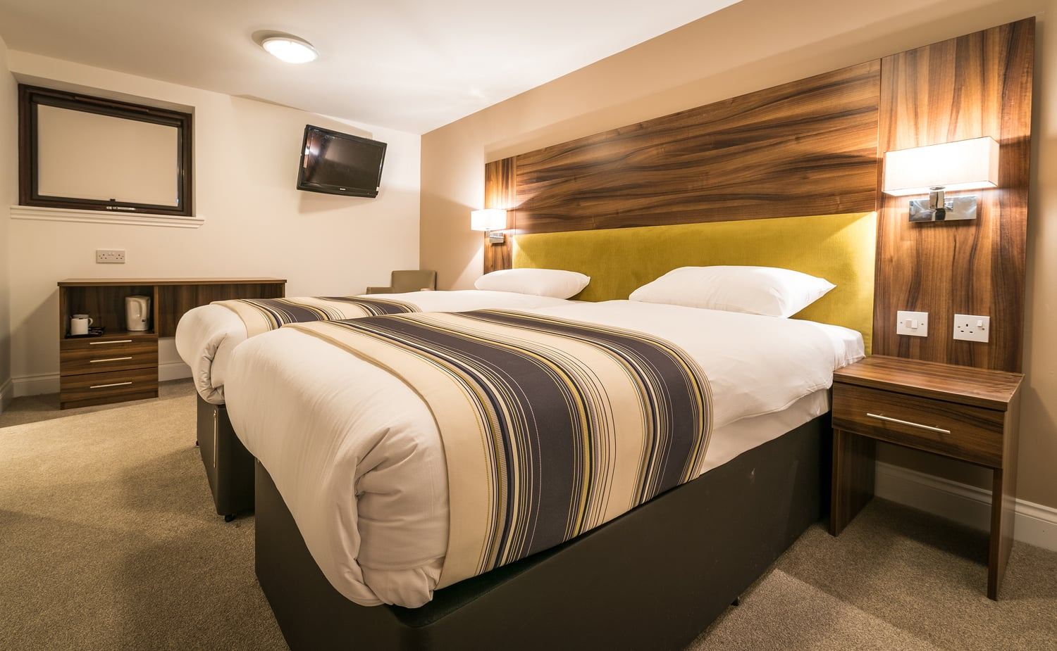 Grand hotel bedroom with wall mounted tvs and modern interior