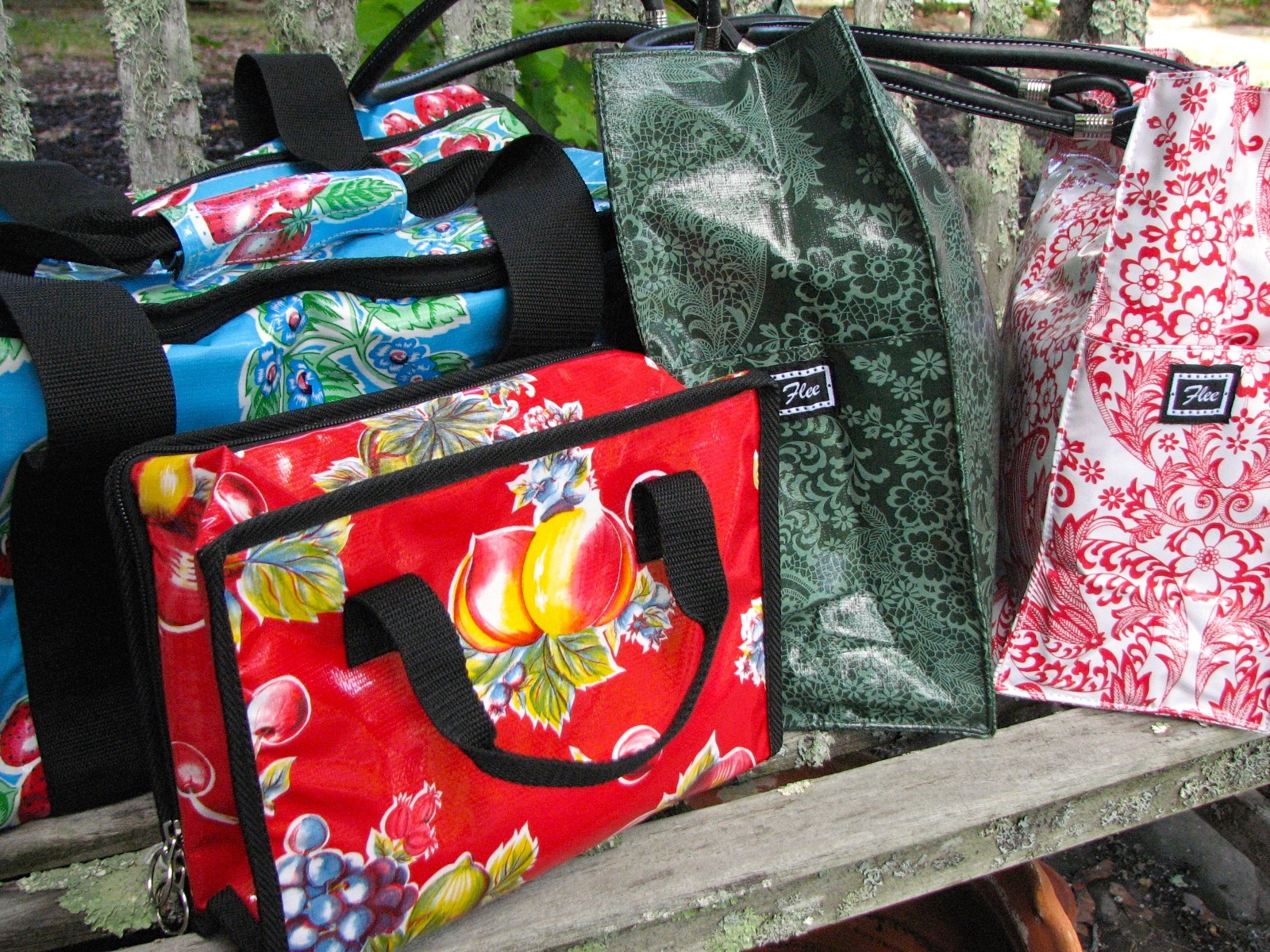 flee bags in heavy oilcloth and cheery patterns.