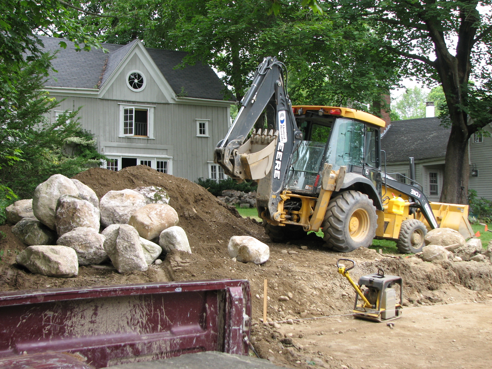 Jon Burns and Adam Saunders prepare the gravel parking area at Carriage House Gardens.
