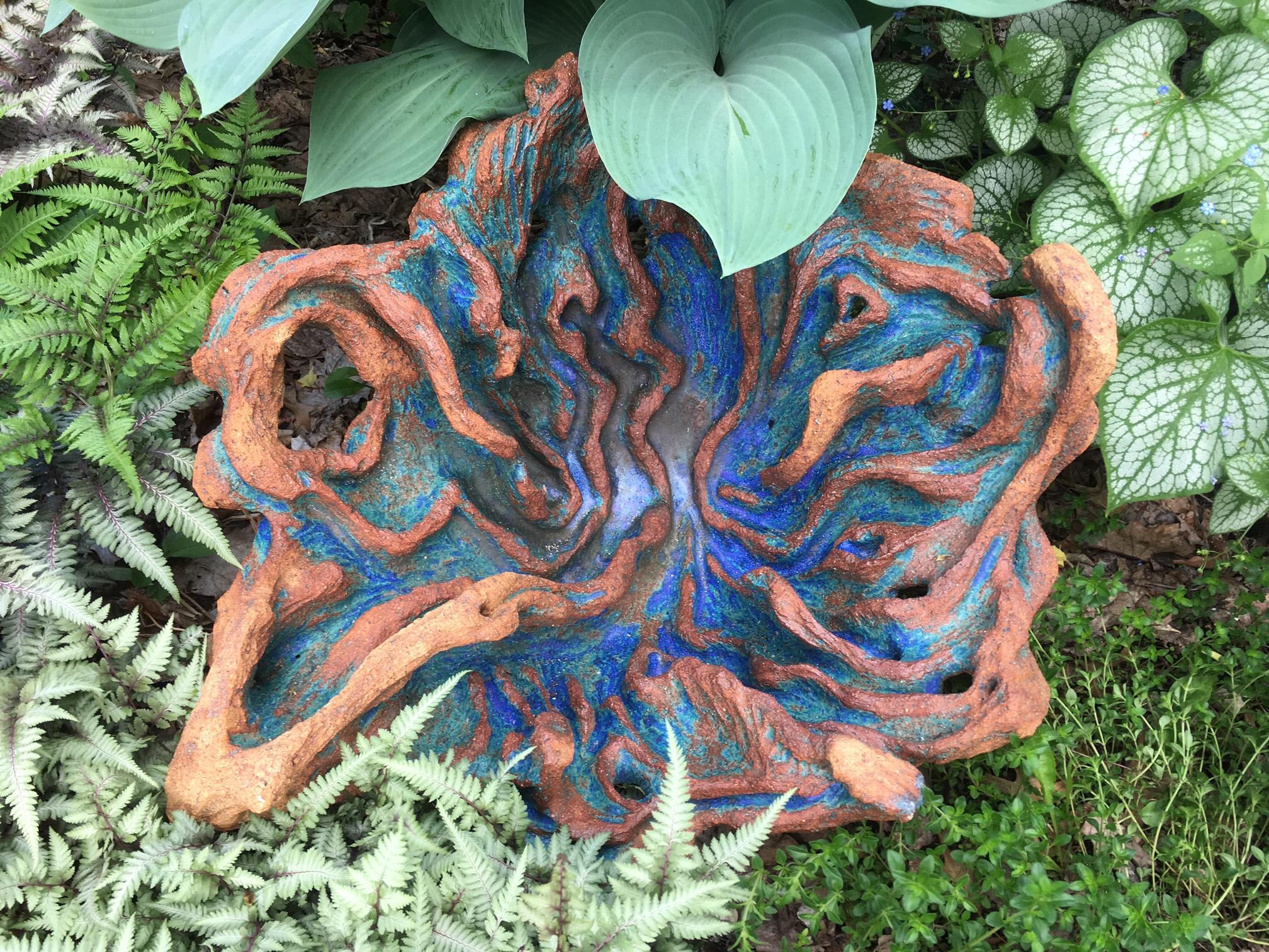 Carved garden bowl, $325.