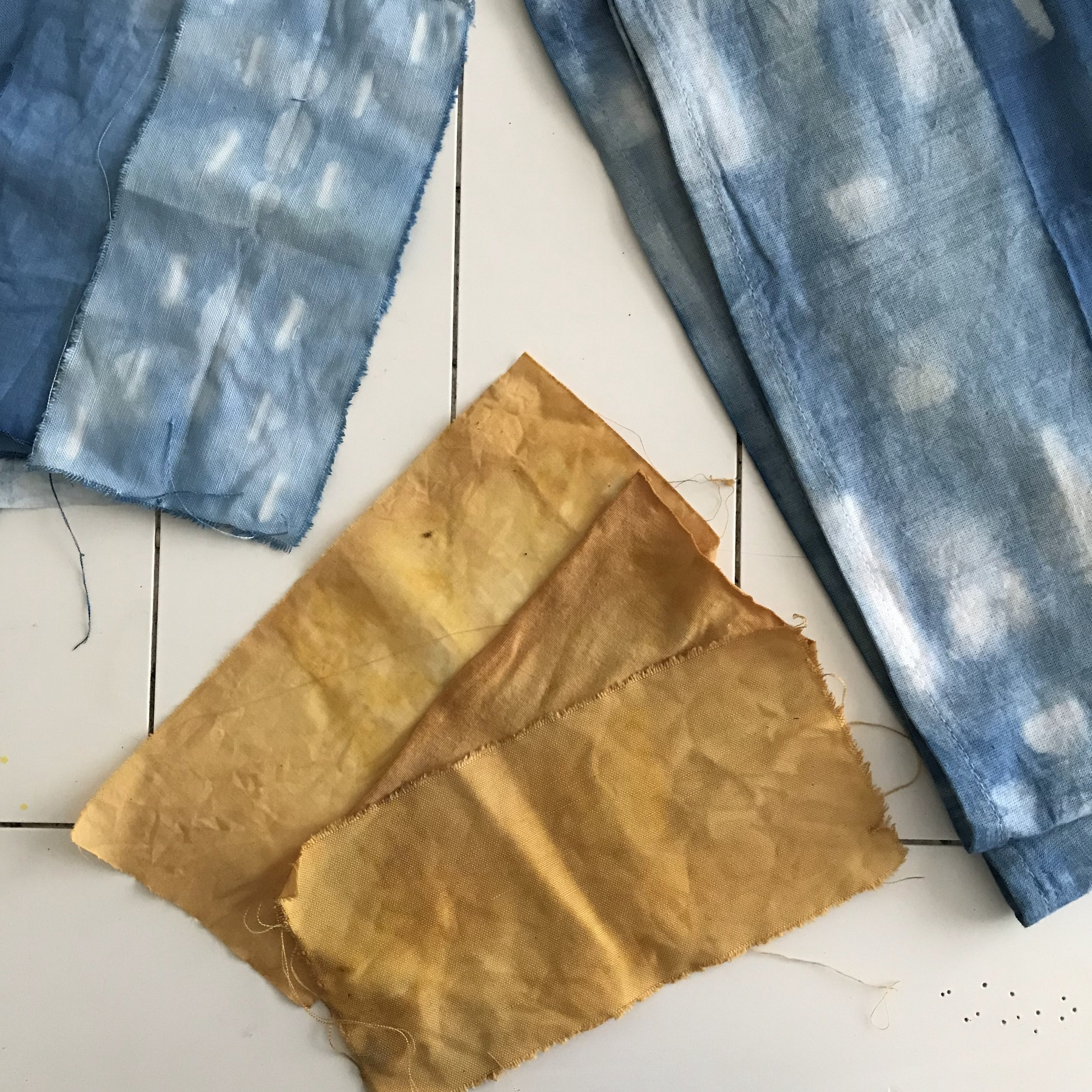 Indigo and onion skin-dyed fabric samples