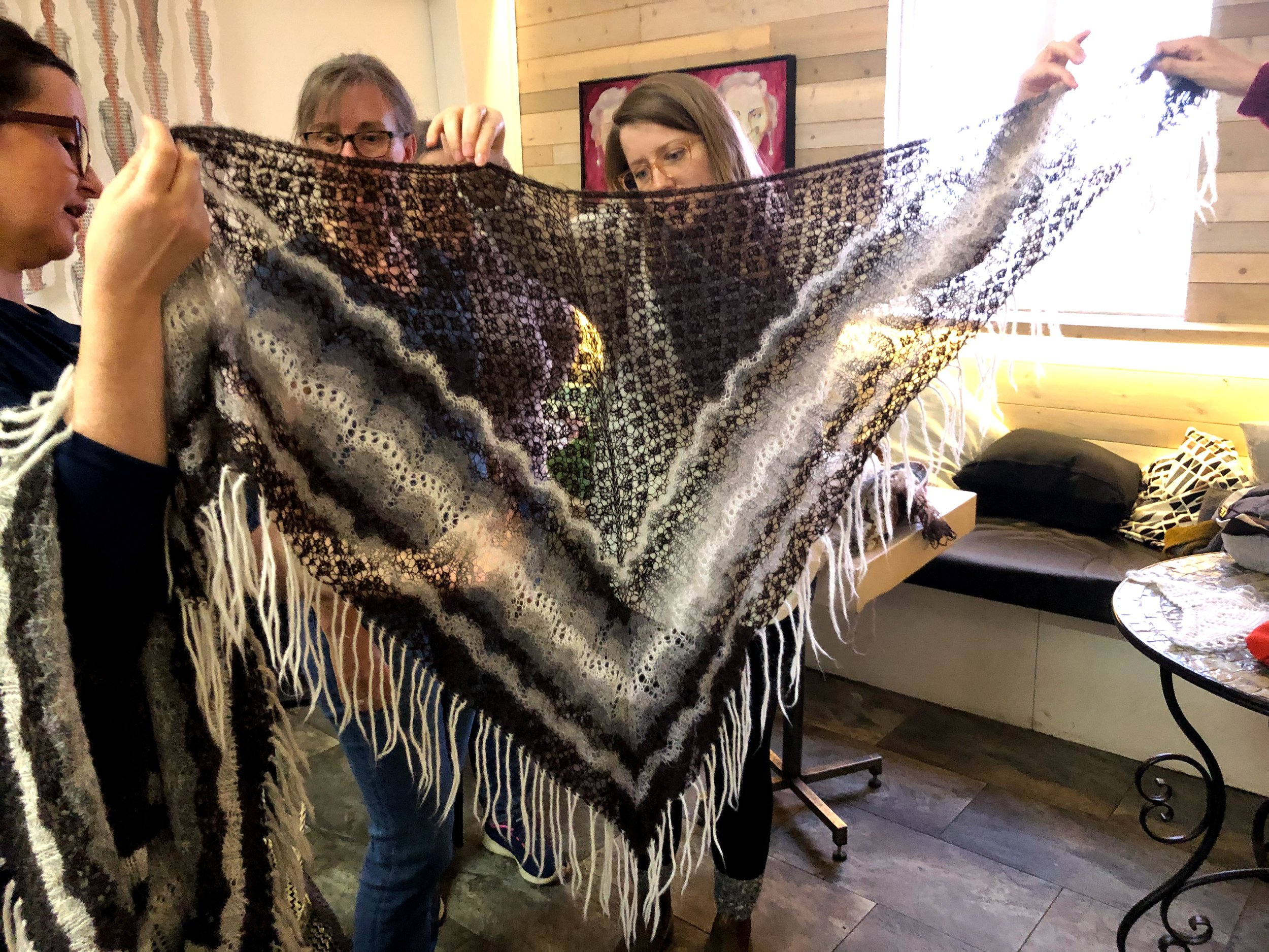 A traditional Icelandic triangle shawl featuring spider lace and undulating lace patterns (thank you Brigitte!)