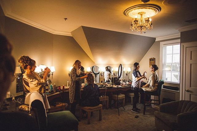 2/3. The magic happening behind the scenes before the big moment. Our team is hard at work glamming up the lovely ladies on Lauren's big day.