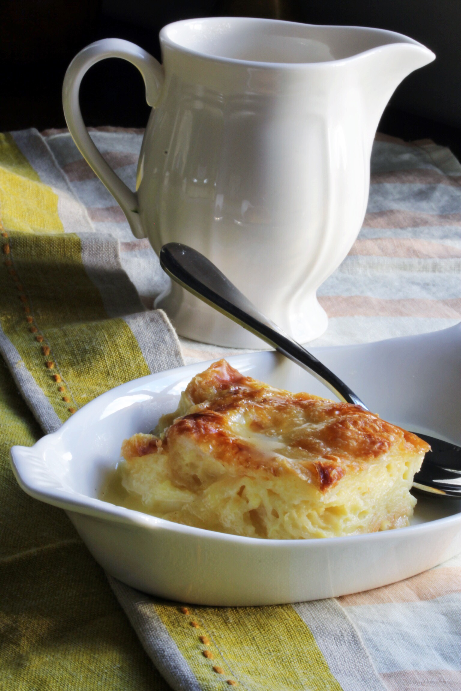 Croissant bread pudding with old fashioned lemon sauce