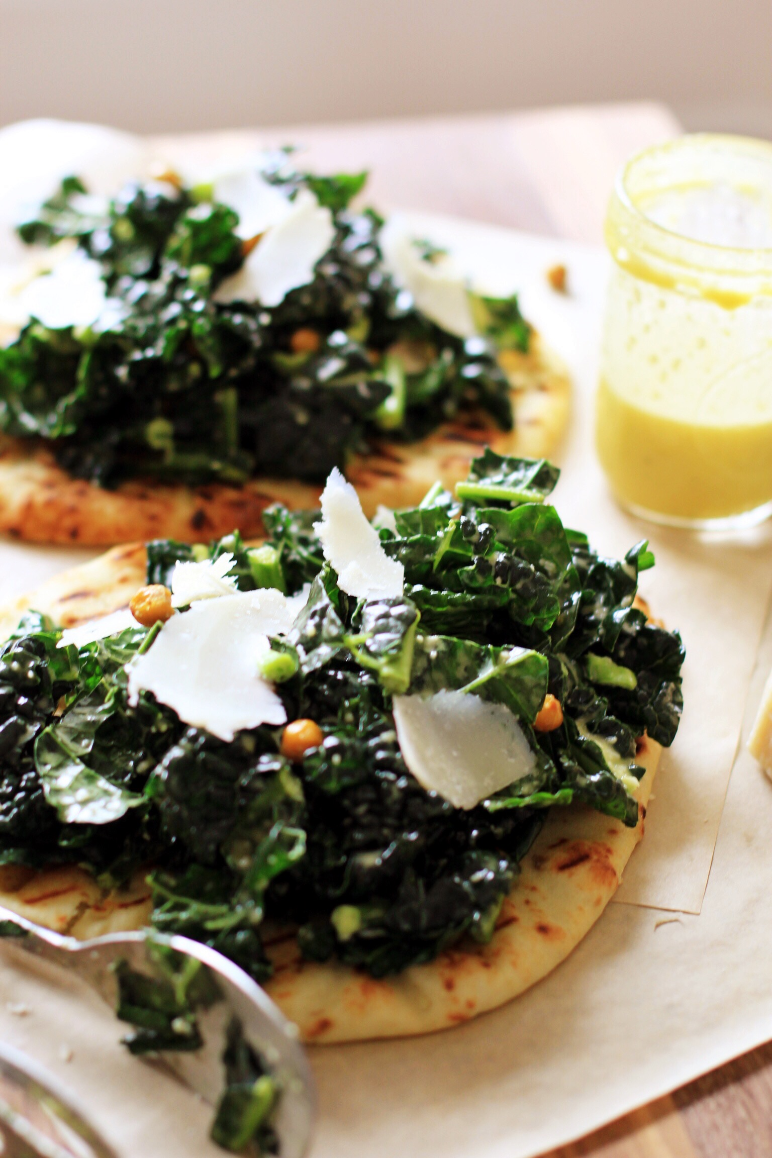 Naan flatbread with hummus and Caesar drenched kale - The Pastiche