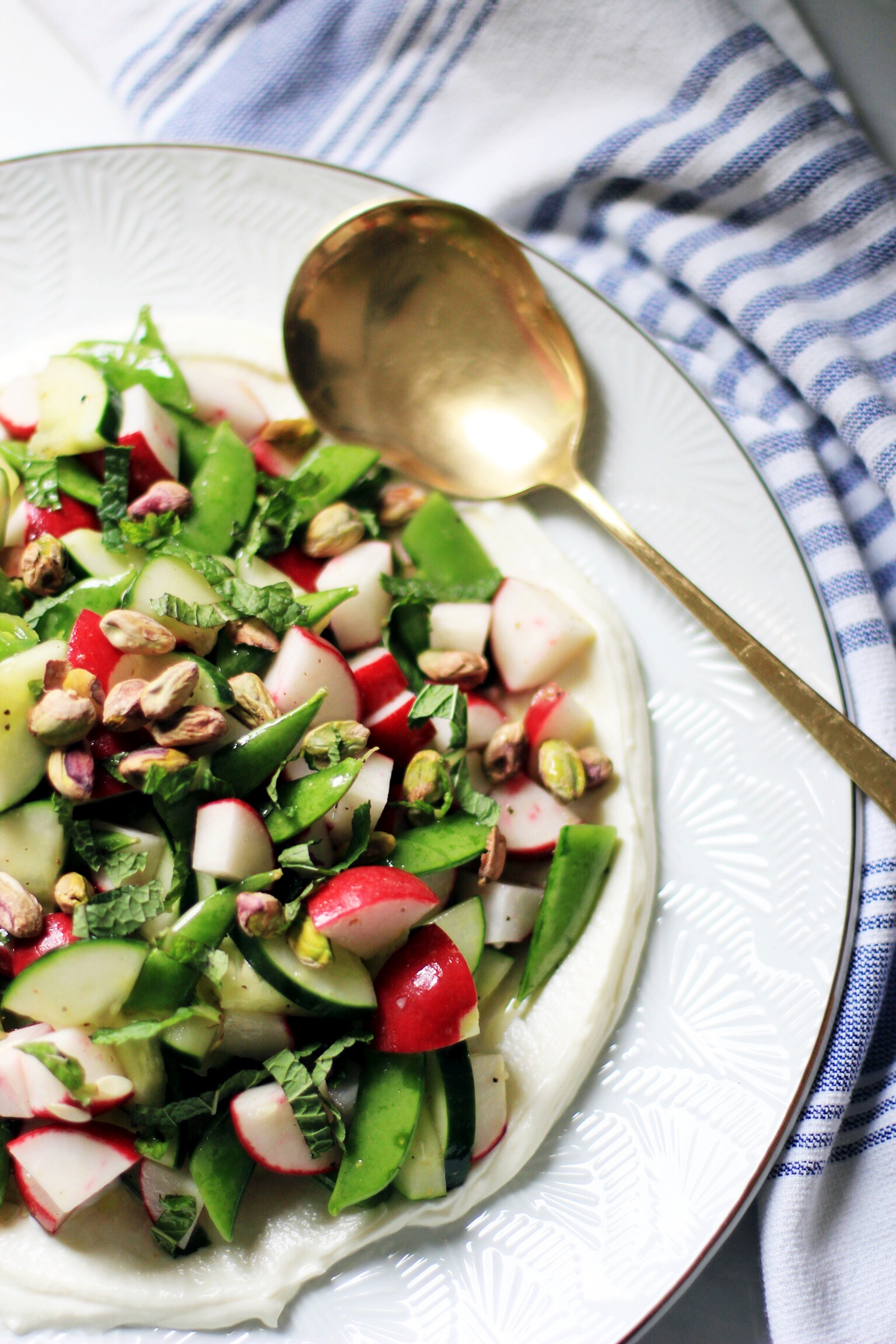 Radish, snap pea, and cucumber salad with mint and yogurt