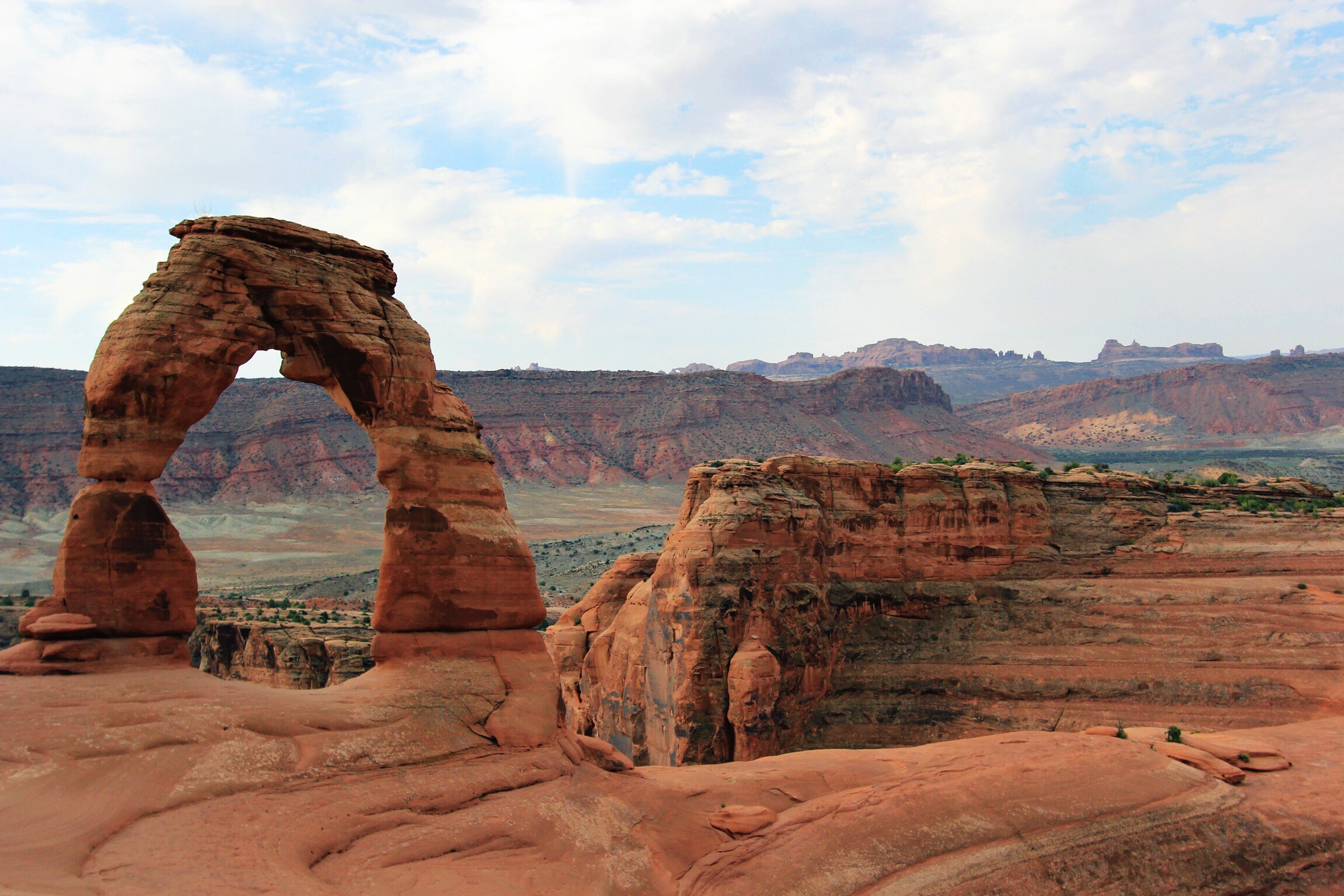 Delicate Arch (and years and years of striated rock)