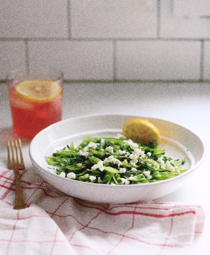 Lemony snap peas with garlic and feta